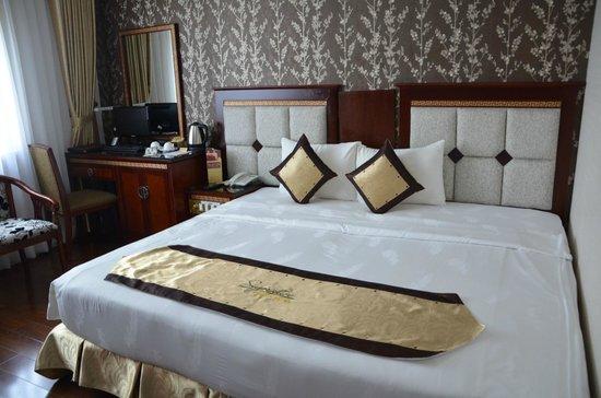 Signature Saigon Hotel: Schlafbereich