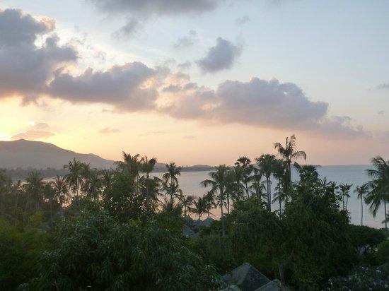 Fair House Villas & Spa : la vue de la terrasse au soleil couchant