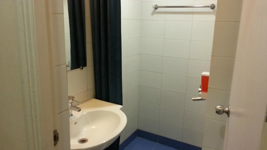 Ginger Ahmedabad: Wash basin, WC, shower area with curtains, 1 towel, 1 hand towel, shower gel and hand gel