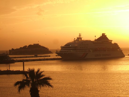 Derici Hotel: A visiting cruise ship at sunset