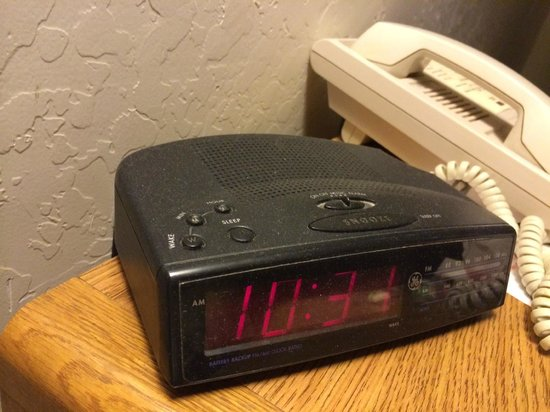 Super 8 Wickenburg AZ : Dusty clock on side table.