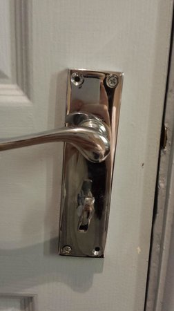 Mottram Hall : door handle held on by 2 screws and not straight - falling off