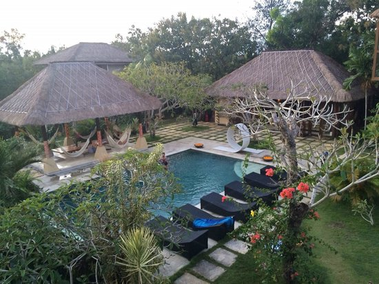 Padang Padang Surf Camp: pool and shaded hammock/chill area and main dining room to the right
