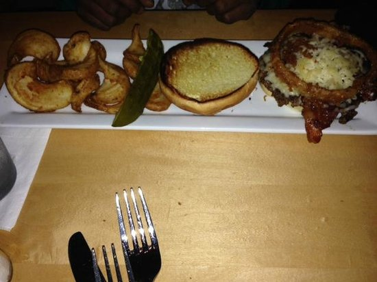 Eddie George's Grille 27 : Burger with bacon, cheese and an onion ring, With potato wedges