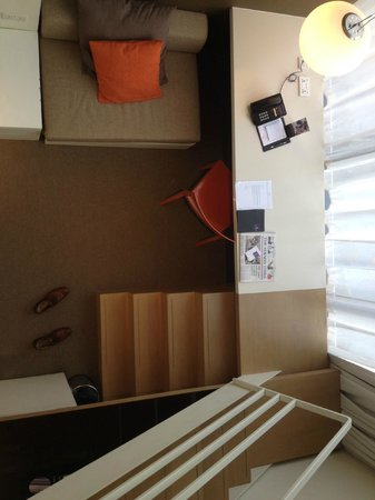 Studio M Hotel: lower level of bedroom with sofa and study desk