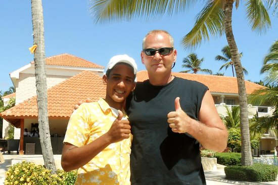 Dreams Palm Beach Punta Cana: My husband Jeffrey with our poolside server Jefry!