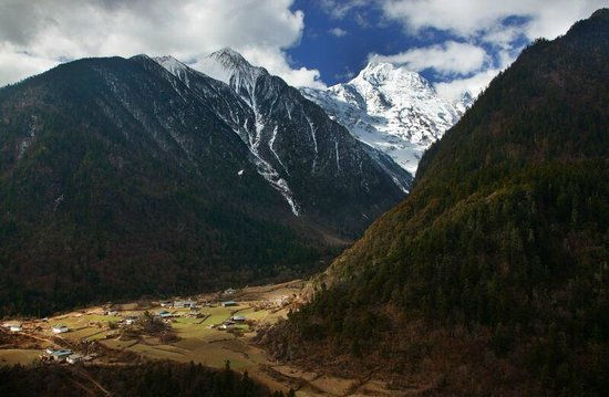 Yubeng Village: View of Lower Yubeng with Meili Snow Mountain on the background
