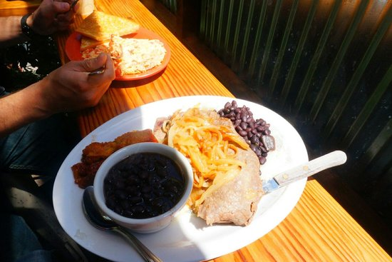 Sol Food Puerto Rican Cuisine : The steak and onions with rice and beans. The other plate is a breakfast meal.