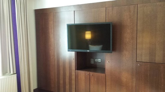 Hilton Brussels City: You had to move the TV to get into the closets.