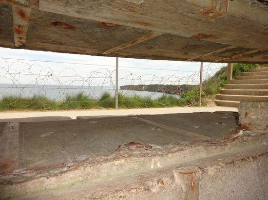 Normandy Sightseeing Tours: From inside Bunker that had flamethrower damage
