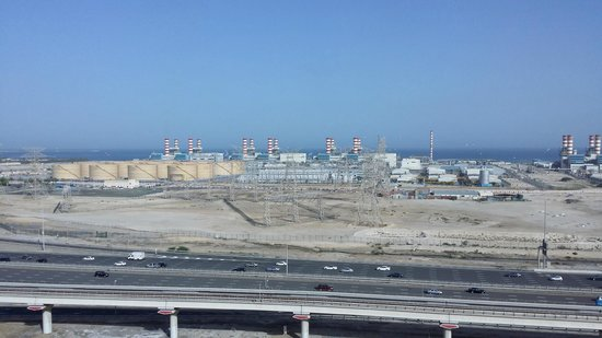 "Movenpick Ibn Battuta Gate Hotel Dubai: ""Sea view""  Lots of industrial action! (view from my room)"