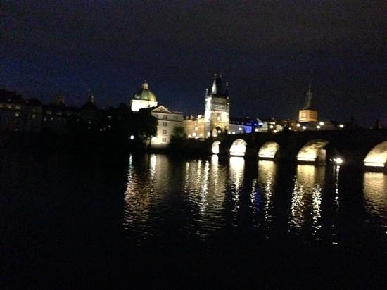 Charles Bridge: view of bridge at night from a river cruise
