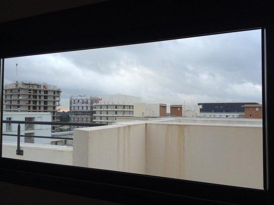 Chambre style villa sur toit Port Marianne: Vue sur les immeubles en travaux