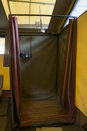 Dunia Camp, Asilia Africa: Shower in tent.