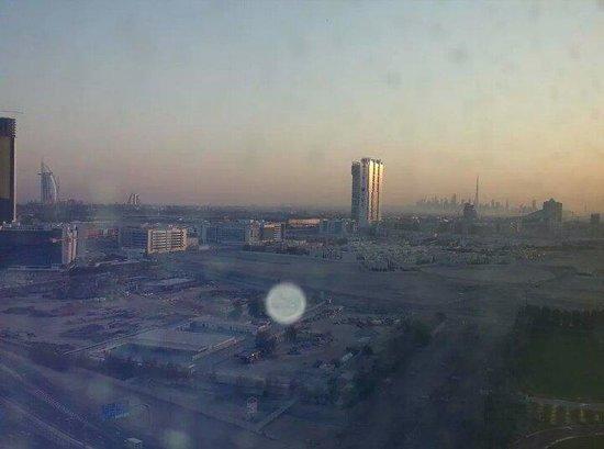 Media Rotana : May 9th 2014 The sun rising from the 17th floor with views of Burj al Arab, Jumeirah Palace, Bur