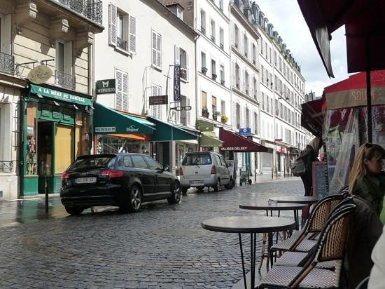 View of Rue Cler after a Spring rain
