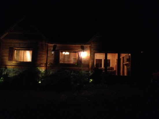 Accommodations by Parkside Resort : View of the cabin at night