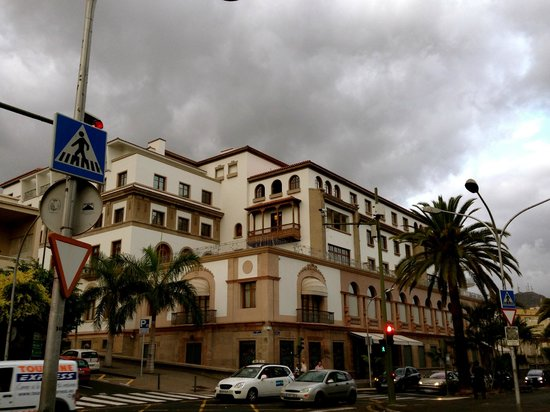 IBEROSTAR Grand Hotel Mencey: Hotel looking ominous with dark storm clouds in the distance.