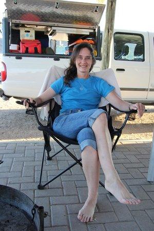 Sossus Oasis Camp Site : Gail enjoying the shade