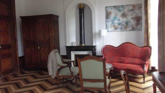 Chambres d'hôtes Manoir de la Manantie : Kamin mit Sitzecke