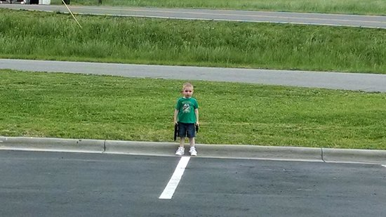 Holiday Inn Express Hotel & Suites Mount Airy South: Our youngest son out in the back playing