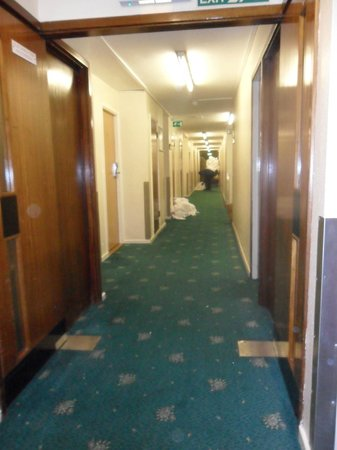 Royal National Hotel: hotel corridor, sticky carpet, dirty laundry in piles