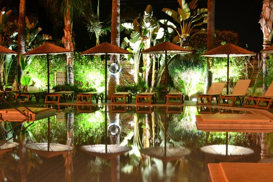 Atlantica Oasis Hotel: Outdoor adult pool by night.