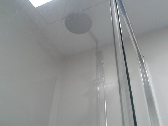 Sun Village: shower corner with big showering head, also with small head with hosepipe