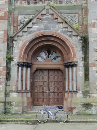 St. Joseph's Catholic Church: My bike parked in front of the porch. It's sad to see broken windows.