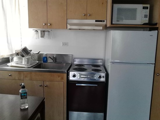 Holiday Surf Hotel : Kitchenette includes pots & pans, glasses, dishes, etc.