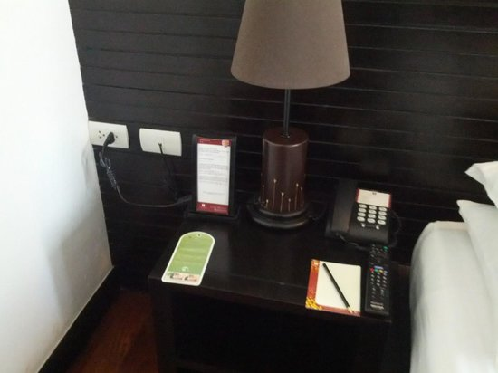 Tara Angkor Hotel: Nightstand with outlet