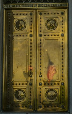 Arkansas State Capitol: Bronze doors with American Flag reflected.