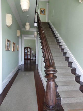West Cliff Inn, a Four Sisters Inn: The grand staircase in the West Cliff Inn.