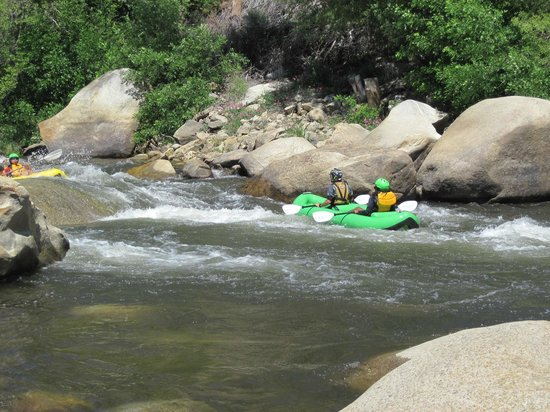 Camp Kernville: Watching kayakers come down the rapids from our private beach at our camp