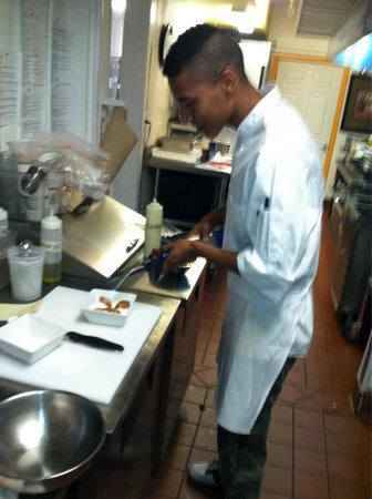 Up the Stairs: Sous chef Isaiah with the torch doing the brûlée