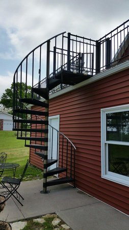 Up Up and Away Lodging: Spiral staircase up to the deck suite.