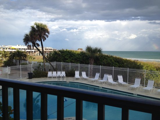 Chateau By The Sea: View of pool from balcony unit 208