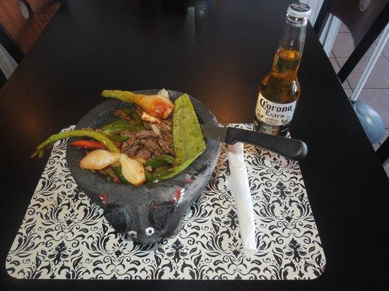 Arandas Tacos: Fajitas Jalisco serve on a molcajete serve with rice, beans and tortillas