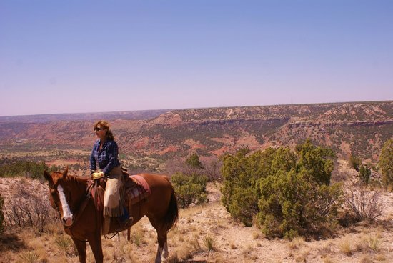 Cowgirls and Cowboys in the West: view of the canyon