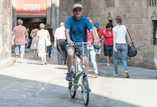 Barcelona Experience: Cruising the Gothic Quarter on one of our high-quality folding bikes.