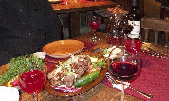 Kavkazskaya Plennitsa: Lamb and beef shashlyk, lamb kebabs and glass of Hvanchkhara red wine
