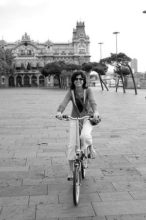 Pedaling through the port district during a Barcelona Experience private bike tour.