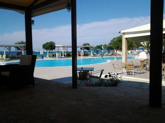 Alykanas Beach Apart-Hotel: view of pool from covered comfy seating area