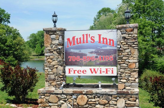 Mull's Inn: Mulls Inn Sign with Lake in Background
