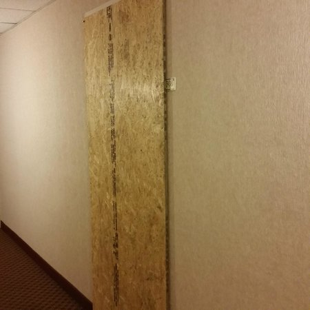Motel 6 Raleigh North: Room 308 boarded up on our floor
