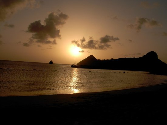 The Landings St. Lucia : Sunset behind Pigeon Island viewed from the beach.