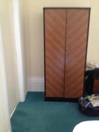 Grand Hotel Scarborough: pile of stuck under and behind the wardrobe. cleaners cutting corners.