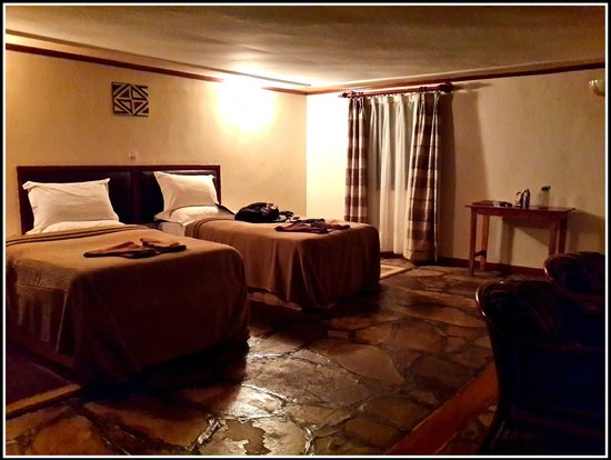Mountain Gorilla View Lodge: Bedding in room