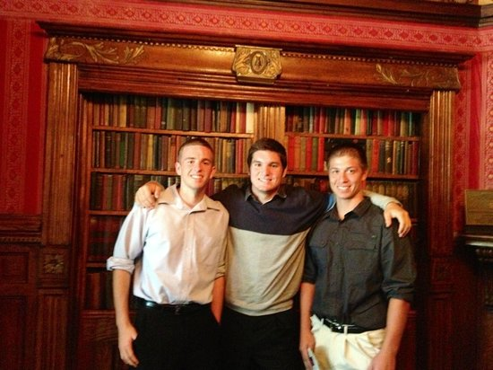 Magic Castle: Son and friends standing in front of the magic bookcase