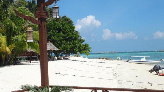 Mabul Water Bungalows: Resort beach is on the other side of the island